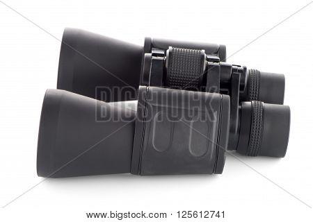 Closeup of black binoculars isolated on white background.