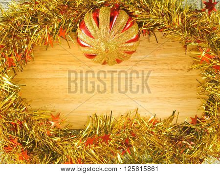 Colorful streamer and golden plastic ball on the wooden board ** Note: Visible grain at 100%, best at smaller sizes