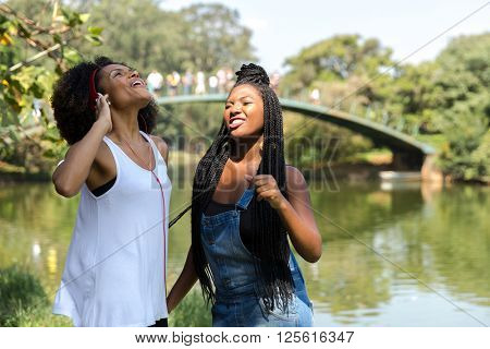 Afro girlfriends enjoying a hot day at the park