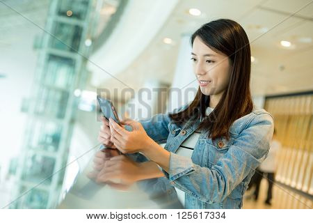 Woman sending sms on mobile phone