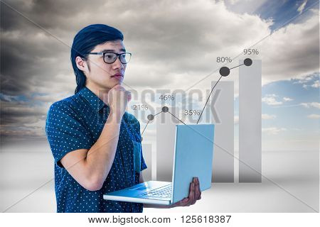 Thoughtful hipster using his laptop against view of percentage on graph