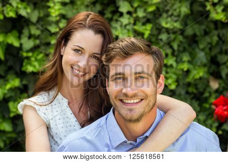 Portrait of happy smiling couple at front yard