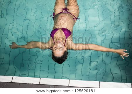 pregnant woman floating in the poo at the leisure center