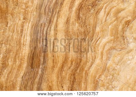 Closeup abstract background texture photo of yellow layer crystalline limestone with natural stripe pattern
