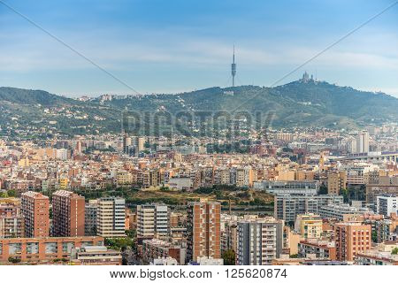 Barcelona Spain - May 18 2014: The view of Barcelona from high up in the Renaissance Barcelona Fira Hotel. Visible on the horizon television tower Collserola and Temple of the Sacred Heart of Jesus.