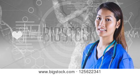 Asian nurse with stethoscope looking at the camera against view of dna