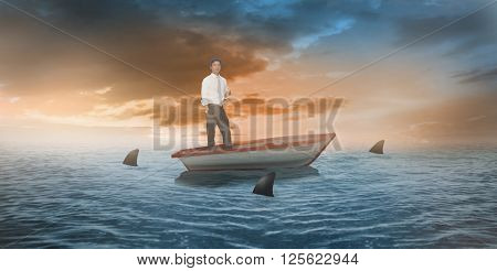 Serious man looking at camera holding champagne flute against sharks circling small boat in the ocean