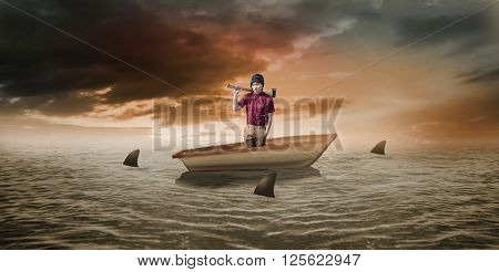 Hipster holding a axe against sharks circling small boat in the ocean