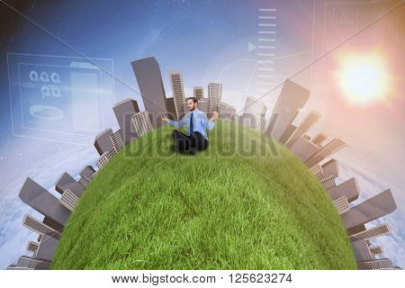 Businessman in suit sitting in lotus pose against white clouds under blue sky