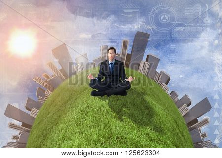Calm businessman sitting in lotus pose against painted sky