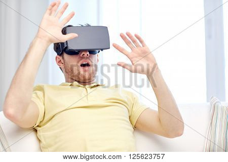 3d technology, virtual reality, gaming, entertainment and people concept - amazed or scared young man with virtual reality headset or 3d glasses playing game