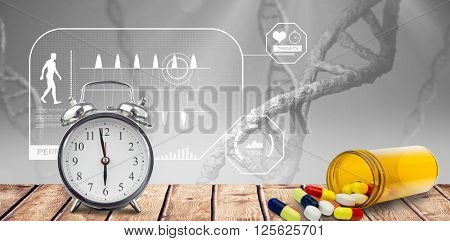 Alarm clock and pills put on a desk against view of dna