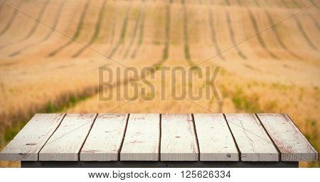 Wooden floor against rural fields