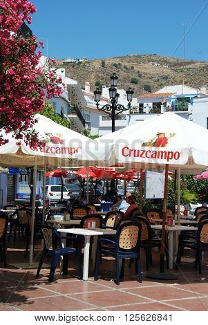 TORROX, SPAIN - JULY 1, 2008 - Pavement cafe in the town square Torrox Malaga Province Andalucia Spain Western Europe, July 1, 2008.