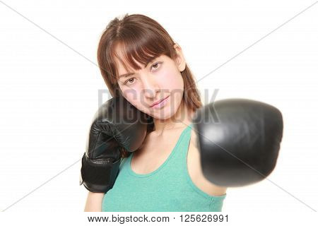 studio shot of female boxer throwing a left jab