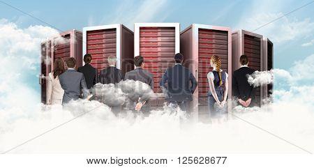 Business team against blue sky