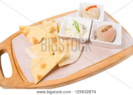 Antipasto platter with italian focaccia and delicious various pates. Isolated on a white background.