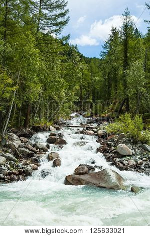 Stream falls in river Akkem. River flowing from glacier and Beluha range. Russia