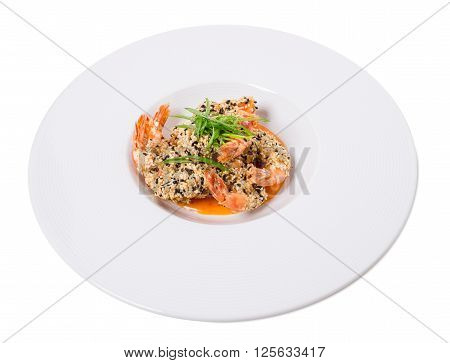 Delicious grilled jumbo shrimps with sesame and sliced scallions on yellow mousse. Isolated on a white background.
