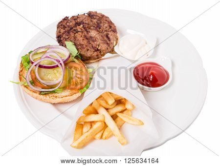 Delicious american grilled beef burger with potato fries and pickled vegetables. Isolated on a white background.