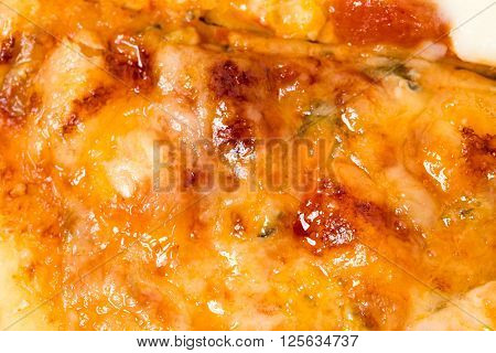 Closeup of melted cheese on sliced neapolitan pizza. Macro. Photo can be used as a whole background.