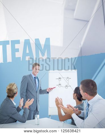 Manager presenting whiteboard to his colleagues against team