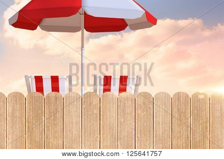Image of sun lounger and sunshade against purple sky over fence