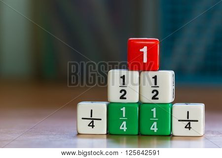 Three levels stacked up color fraction dices blurred background