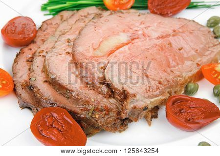 beef barbecue served on big white dish over wood