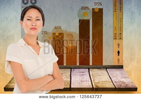 Business colleagues with arms crossed in office against wooden shelf