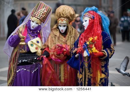 Three People Are Dressed For The Carnivale In Venice,Italy