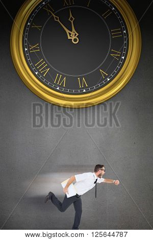 Geeky young businessman running late on a grey background with a clock