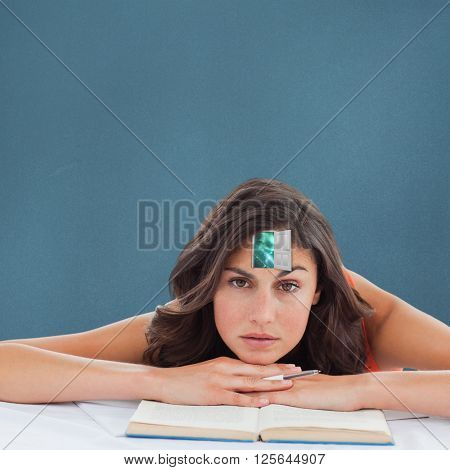 Frowning student head on her books against blue background