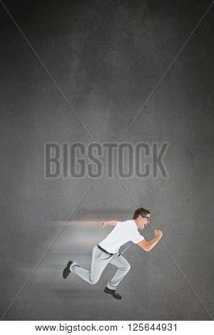 Geeky happy businessman running mid air on grey background