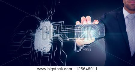 Businessman showing his smartphone screen against fingerprint on circuit board