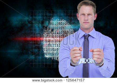 Handsome businessman wearing handcuffs against digital security finger print scan