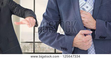 Businessman keeping money in jacket against window overlooking city