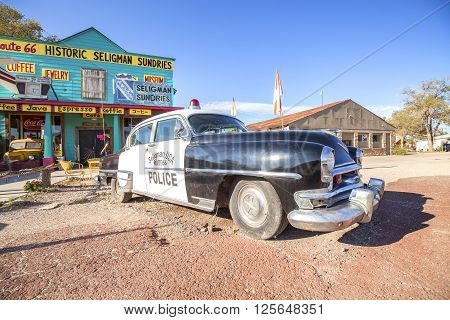 Seligman USA - September 10 2015: Old police car in front of historic Sundries Building. The town was on the original U.S. Route 66 from 1926 through 1978 when Interstate 40 bypassed it on south.