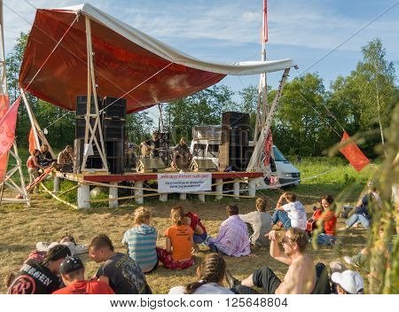 Near Obninsk, Russia - June 11, 2007 - Musical band performs at the stage of folk music festival
