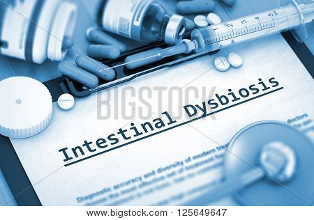 Intestinal Dysbiosis, Medical Concept with Selective Focus. Diagnosis - Intestinal Dysbiosis On Background of Medicaments Composition - Pills, Injections and Syringe. 3D.