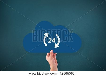 Hand holding cloud against teal, blue background