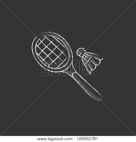 Shuttlecock and badminton racket. Drawn in chalk icon.