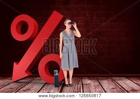 A businesswoman looking through binoculars against a dark wall