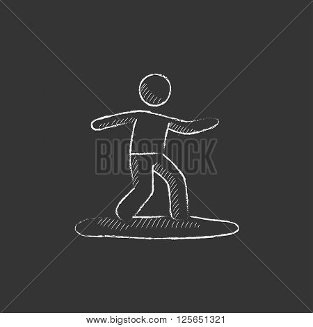 Male surfer riding on surfboard. Drawn in chalk icon.