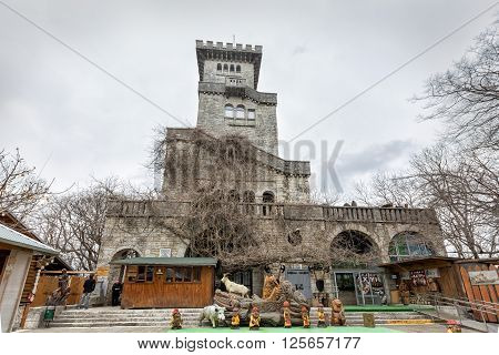 Sochi, Russia - February 6, 2016: Observation tower in the medieval Romanesque style, on top of the mountain Akhun. Opened June 6, 1936