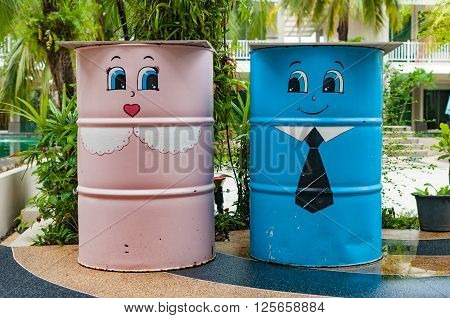 Colorful bin in a garden with cute charactor