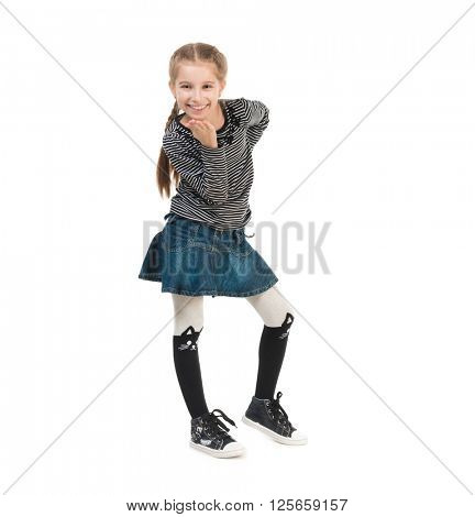 smiling pretty little girl in trendy clothes blowing air kiss isolated on white background
