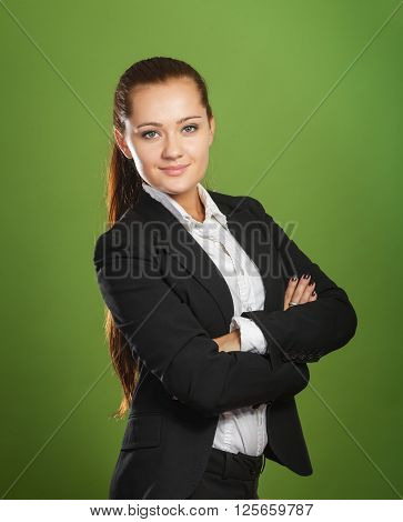 Business woman on green background. Stock photo.