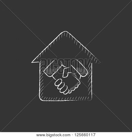Handshake and successful real estate transaction. Drawn in chalk icon.