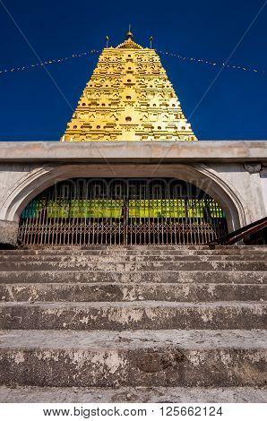 Golden Bodh Gaya pagoda with blue sky in district Sangkhlaburi Kanchanaburi country of Thailand